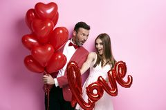 Loving couple with red balloons Stock Photo