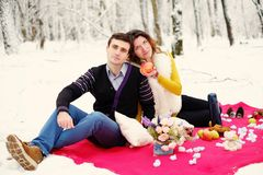 Loving couple with a red blanket in the winter Stock Image