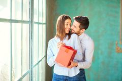 Loving couple with red gift box royalty free stock image