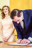 Loving couple in the registry office Royalty Free Stock Photo