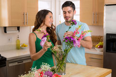 Loving couple in a relationship share flowers on valentines day Stock Photos