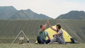 Loving couple relax and have fun outdoors in front of the tent in sunny weather. stock footage