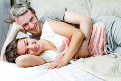 Loving couple relaxing on bed Stock Photo