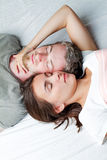 Loving couple relaxing on bed Stock Image