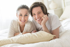 Loving Couple Relaxing In Bed Stock Photography