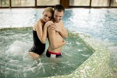 Loving couple relaxing in hot tub. In spa royalty free stock photos