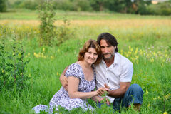 Loving couple relaxing on a meadow Stock Images