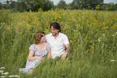 Loving couple relaxing on a meadow Stock Photo