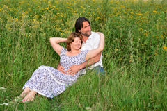 Loving couple relaxing on a meadow Stock Photos