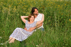 Loving couple relaxing on a meadow Stock Photography