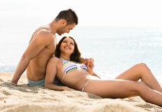 Loving couple relaxing on sand beach Royalty Free Stock Photography