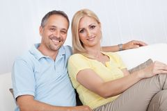 Loving couple relaxing on a sofa Stock Photography