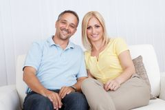Loving couple relaxing on a sofa Stock Photo