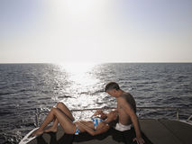 Loving Couple Relaxing On Yacht Stock Photo