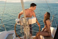 Loving couple relaxing on a yacht. Stock Photography