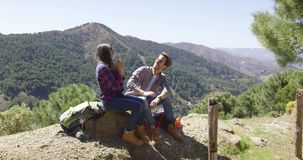 Loving couple on rest in mountains stock footage