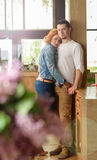 Loving couple in restaurant. A women with a young men cuddling in a restaurant Stock Photography