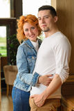 Loving couple in restaurant. A women with a young men cuddling in a restaurant Royalty Free Stock Image