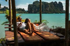 Loving couple resting in Asia. A young couple travels to exotic countries. Man and woman at the resort. Couple resting in Thailand. Loving couple resting in Asia stock photography