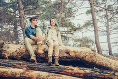 Loving couple resting in the forest Stock Photo
