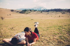 Loving couple resting in nature. Spending free time together. Enjoying the holidays. Lying on a meadow.Pair spending time in nature.Camping and having picnic royalty free stock image