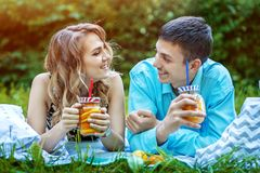 Loving couple resting in the park. The concept is healthy food, lifestyle and summer stock photos