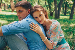 Loving couple resting in summer park Stock Image
