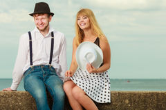 Loving couple retro style dating on sea coast Royalty Free Stock Image