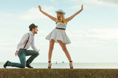 Loving couple retro style dating on sea coast Stock Photography