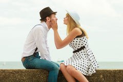 Loving couple retro style dating on sea coast Stock Images