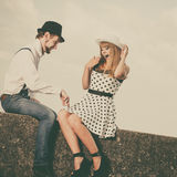 Loving couple retro style dating on sea coast. Summer holidays love relationship and dating concept - romantic playful couple retro style flirting on sea shore Royalty Free Stock Photos