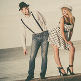 Loving couple retro style dating on sea coast Royalty Free Stock Photography