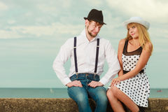 Loving couple retro style dating on sea coast Royalty Free Stock Photo