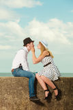 Loving couple retro style dating on sea coast. Summer holidays love relationship and dating concept - romantic playful couple retro style flirting on sea shore Royalty Free Stock Image