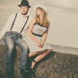 Loving couple retro style dating on sea coast Stock Image