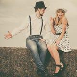 Loving couple retro style dating on sea coast Royalty Free Stock Photography