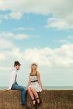 Loving couple retro style dating on sea coast Royalty Free Stock Photos