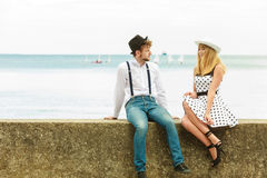 Loving couple retro style dating on sea coast. Summer holidays love relationship and dating concept - romantic playful couple retro style flirting on sea shore Stock Photos