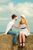 Loving couple retro style dating on sea coast Stock Images