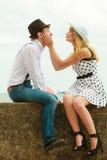 Loving couple retro style dating on sea coast Stock Photo