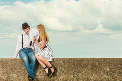 Loving couple retro style dating on sea coast. Summer holidays love relationship and dating concept - romantic playful couple retro style flirting on sea shore Stock Photo