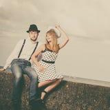 Loving couple retro style dating on sea coast Stock Photography
