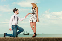 Loving couple retro style dating on sea coast Royalty Free Stock Images