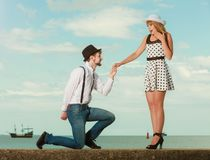 Loving couple retro style dating on sea coast Royalty Free Stock Photo