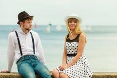 Loving couple retro style dating on sea coast Royalty Free Stock Image