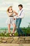 Loving couple retro style flirting outdoor Royalty Free Stock Photo