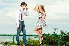 Loving couple retro style flirting outdoor Stock Image