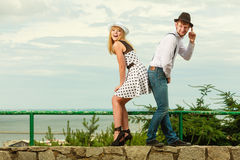 Loving couple retro style flirting outdoor Stock Photography