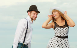 Loving couple retro style flirting outdoor Stock Images