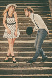 Loving couple retro style flirting on stairs Royalty Free Stock Photo